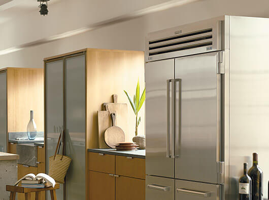 Stainless steel Sub-Zero Pro48 in a light colored kitchen
